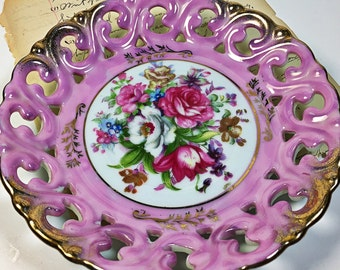 """Vintage 6"""" Pink Royal Sealy China plate saucer with intricate cut outs, gold accents and roses.  Very good condition."""
