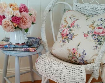 Pretty vintage cushion in the softest pastels