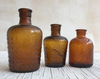 A antique amber glass collection: 3 large/medium size jars. Retro decor or use as paint or ink pots. Boots Lysol, Lysol, unmarked.