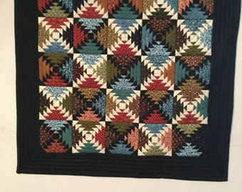 "Miniature quilt, 19"" square. Black backing, machine quilted. Wall hanging or table topper."