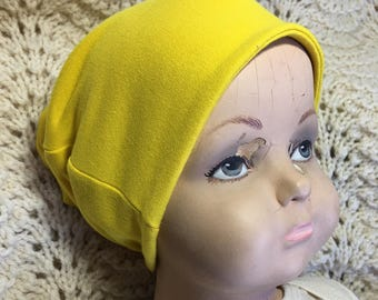 Dark Yellow Organic Slouch Cap Hat. Cool organic cotton hat in sizes preemie to 6 years. Seven color options available.