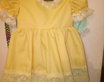very pretty yellow rebrn doll dress