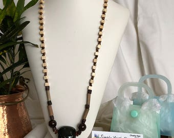 Ceramic focal with wood and glass beads
