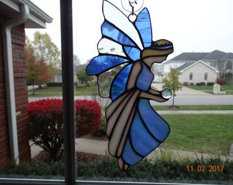 Stained glass fairy with crystal ball