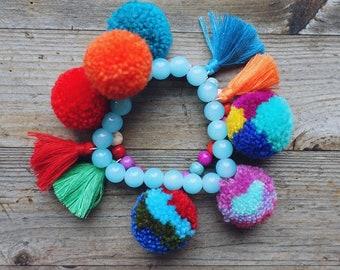 Bohostyle blue bracelet , pompoms bracelet, bohostyle, ibiza style,