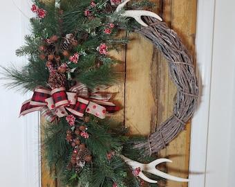 Woodland  wreath, winter wreath, Christmas wreath, antlers, ornaments, greenery, rusty bells, berries, grapevine wreath, pine cones,