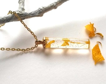The necklace with tiny petals of the Marigold Yellow Flower