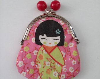 "Handmade purse made in ""little chineese"" print fabric lined with green fabric."