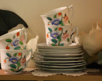 VINTAGE CUPS & SAUCERS, made in Japan, 1920's - 40's. set of 4 trios.