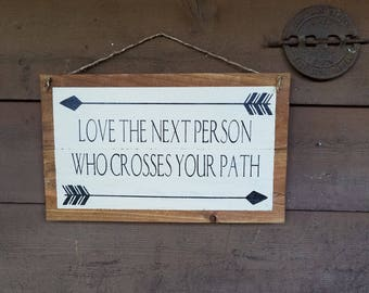 Love the next person who crosses your path.....hand painted sign on pallet/fence boards.