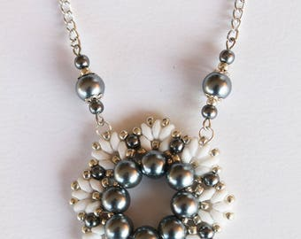 Necklace with flower corolla pendant hematite and white