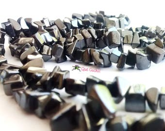 Row of 250 chips about stone Hematite