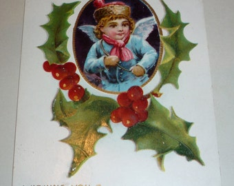 Little Boy Angel in Blue Surrounded by Holly Antique Postcard