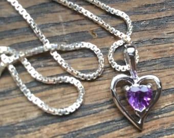 Danty sterling silver heart with amethyst .
