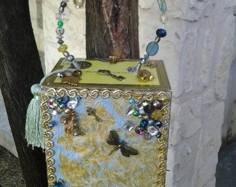 Cigar Box Purse, sky blue hand painted fabric, decorated with many metal charms, old key, dragonfly, clock face, crown, beaded handle & more