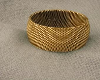 Intricately woven brass mesh cuff