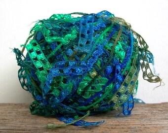 trendsetter cubetti . ocean waters 972 . novelty ribbon flag art yarn . 75yd . royal blue teal green checked ladder flags discontinued yarn
