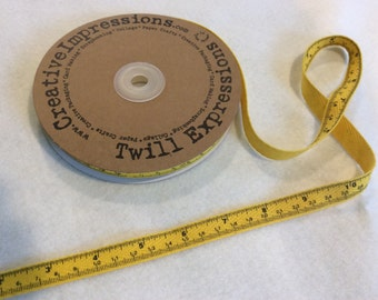 Tape Measure Twill - By Creative Impressions - Yellow - 25 Yard Roll - 13.50 Dollars - 1/2 inch wide