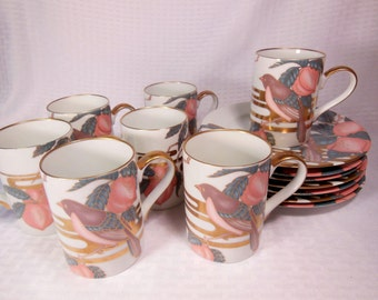 Very Pretty Dessert Set Vintage  FITZ and FLOYD NIGHTINGALE 7 Cups / Mugs and 7 Dessert Plates.  The Set was made in 1982.