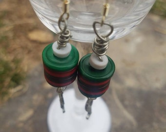 Button earrings with a charm