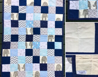 Patchwork Crib Quilt in greys and blues with elephants detail. Waffle cotton backing.