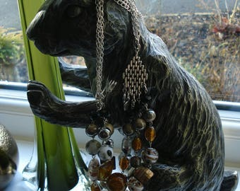 Multi stranded neutral coloured beaded necklace