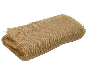 Burlap table runner with unfinished fringe edges. Made with 100% natural jute-burlap.