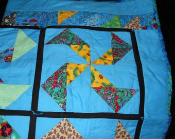 Pinwheel Blue Quilt Small for Infants Toddlers Or maybe a lap quilt for Nanny in blue prints backing ocean fish
