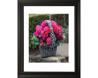 Pink Flowers in a Grey Basket thetravelingcamera