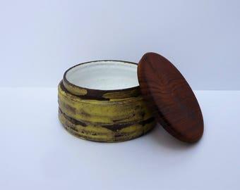 Retro ceramic jar with wooden lid