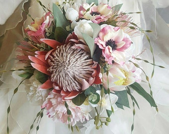 Rustic boho wedding bouquet for bride or bridesmaid Rustic proteas with peonies, anemones, orchids, lush foliage.  Pretty & eclectic flowers
