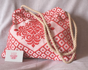 Bag in Sardinian fantasy fabric with red and white decoration, with long handles