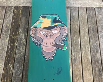 Hand painted skateboard designs