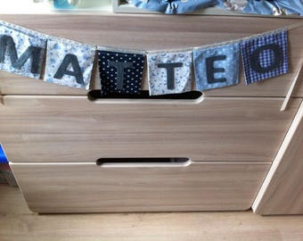 """pockets"" square with name in shades of blue Garland"