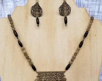 An Eclectic style pendant and earrings.  A one of a kind jewelry piece! Made with labradorite, Swarovski crystals and blackonyx.