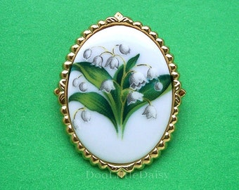 Beautiful Porcelain Lily of the Valley Flower Bouquet Cameo on a Goldtone Frame May Birth Flower Costume Jewelry Pin Brooch Pendant for Gift