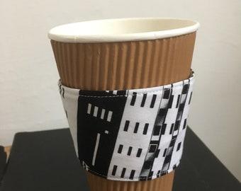 Skyscraper coffee cozy