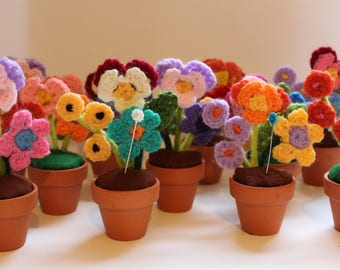 Crochet flower in pot pin cushion