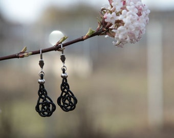 Earrings with braided shape and stainless steel Klappbrisur with ornament