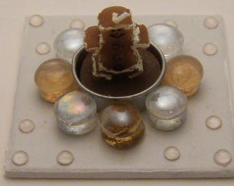 Handmade candle holder with candle-gingerbread man