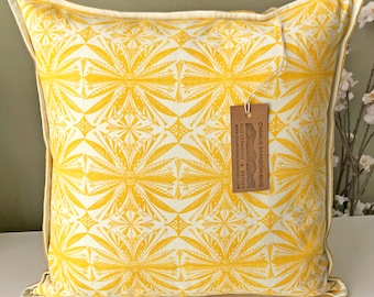 Block-printed, handmade cushion in primrose yellow