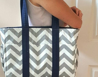 Diaper bag, messenger diaper bag, medium with elastic bottle pockets.  Grey and white chevron with navy blue