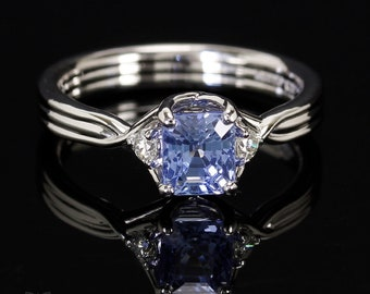 Emerald cut light blue sapphire crossover ring