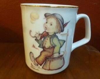 Hummel The Merry Wanderer mug by Reutter Porzellan Germany