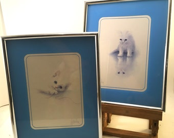 Pair white fluffy kitten cat prints silver plastic metal look frames w/blue mat under acrylic signed Harrison