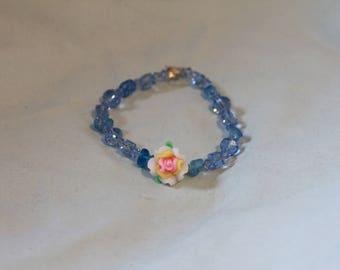 Clear blue bracelet with flower center.