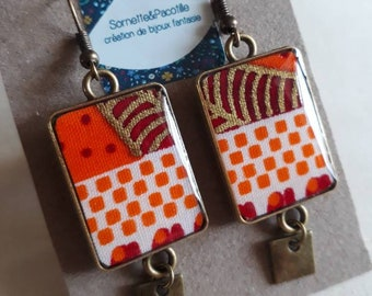 Earrings orange rectangular bicolor white wax and gold asymmetrical. Cabochon 15x28mm/resin/edition limited bronze finish
