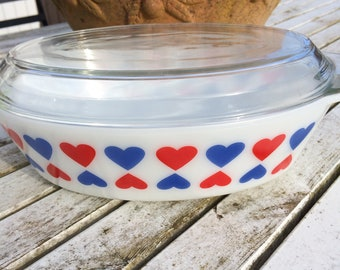 A very nice no 524 vintage JAJ Pyrex blue and red Hearts pattern casserole with lid 70s