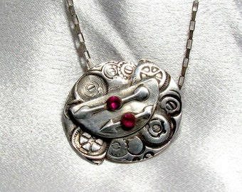 """Item 6018 - """"Point the Way""""  Handcrafted, sculpted and carved  999 Fine Silver with Lab Grown Rubies"""