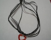 Heart pendant and black o...